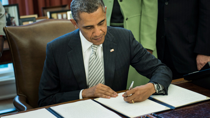 obama signs monsanto act