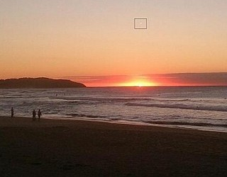 Multiple Witnesses on Australia Beach Spot Bright Hovering UFO