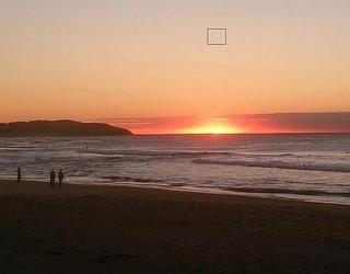 Multiple Witnesses on Australia Beach Spot Bright Hovering UFO