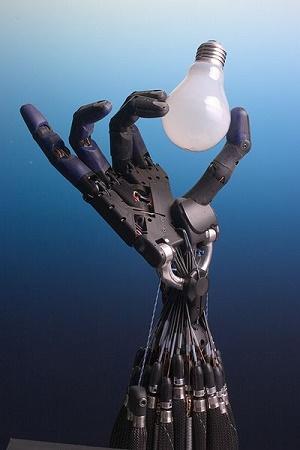 robot changing a light bulb